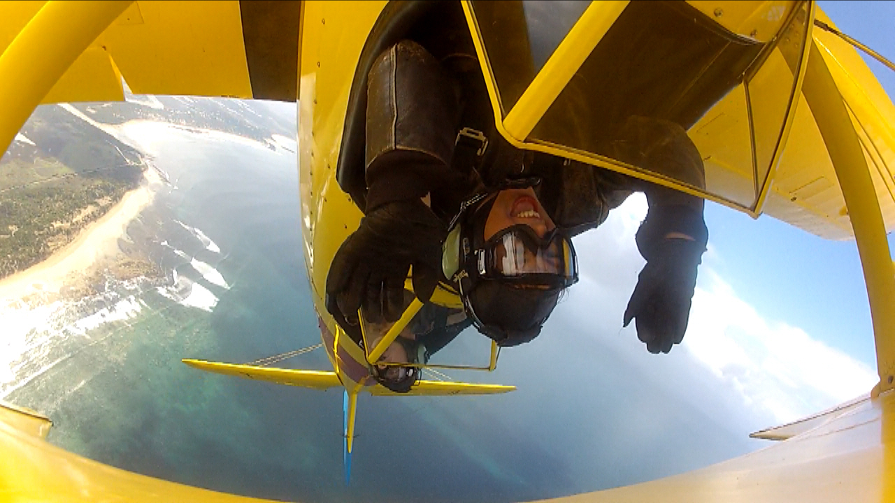 Flying upside down in a Tiger Moth World WW2 biplane over Torquay