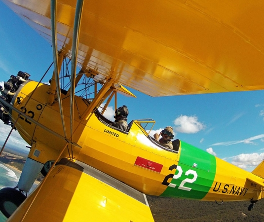 Tiger-Moth-World-plane-over-Point-Addis